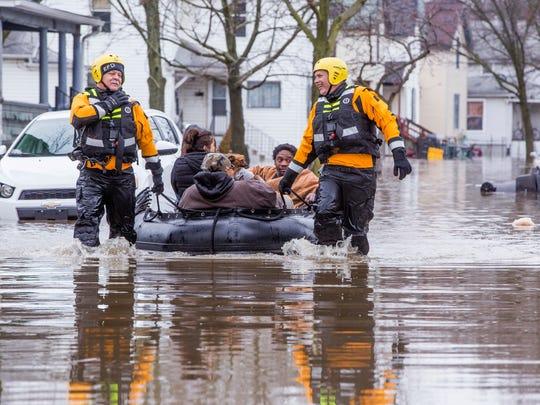 Emergency crews help evacuate residents Wednesday in Elkhart, Ind.
