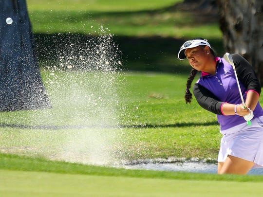 Aneka Seumanutafa of Frederick, Maryland, blasts out of green side bunker at the 17th hole on Monday, March 28, 2016, during the 2016 ANA Junior Inspiration golf tournament on the Arnold Palmer Course of Mission Hills Country Club in Rancho Mirage, Calif.