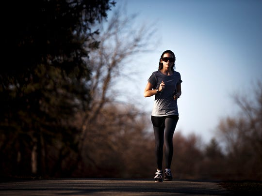 "Running is a sport that doesn't involve balls, which is one of the reasons Alexis Myers, 15, says she likes it so much. ""I don't like getting hit in the face."" Myers is training for the upcoming track season. That means she runs two miles around a cemetery by her family's home in Manson, Ia., on Friday, March 11, 2016."