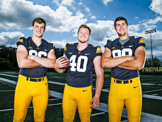 The Hawkeyes defensive ends from left, Matt Nelson, Parker Hesse, and Anthony Nelson pose for a portrait during media day on Saturday, August 6, 2016 in Iowa City.