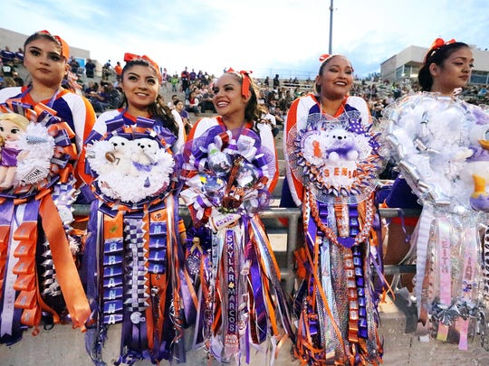 Eastlake cheerleaders wear their mums before the start of their homecoming game against Bel Air Thursday at the Socorro Activities Complex. They are from left: Lisa Harman, left, Brianna Escamilla, Skylar Borunda, Sara Trevizo and Vivian Perez.