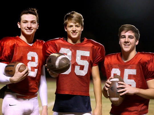 Oakland's kicking team (L to R) Brevin Linnell , holder;