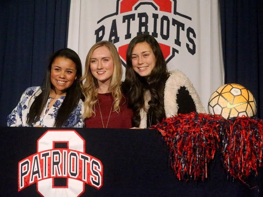 Three Oakland soccer players (L to R) Ajah Liggin, signed with Carson-Newman, Jenna Clothier signed with Maryville and Madison Seacrist, signed with Trevecca, to play soccer  on National Signing Day, on Wednesday, Feb. 1, 2017.