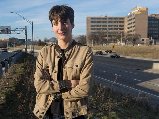 Emily Kutil poses for a portrait on Friday, Feb. 17, 2017 near Chrysler Freeway in Detroit. Kutil found hundreds of photographs in the Burton Historical Collection of the Detroit Public Library, of homes and buildings in the long-demolished downtown district that once was known as Black Bottom.
