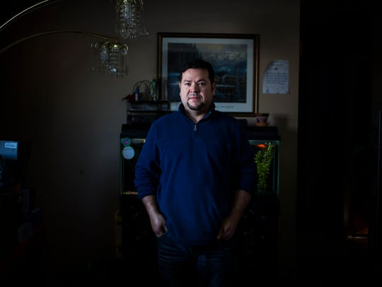 Elmer Pena, 38, from El Salvador, has a lot to lose. His house, car, job and his temporary protected status (TPS). President Trump announced late last year that TPS protected immigrants would lose their visas. Unlike undocumented immigrants, TPS recipients have documents so many own homes, cars and other personal property. Here, Pena poses for a portrait inside his Indianapolis home on Thursday, Jan. 4, 2018.