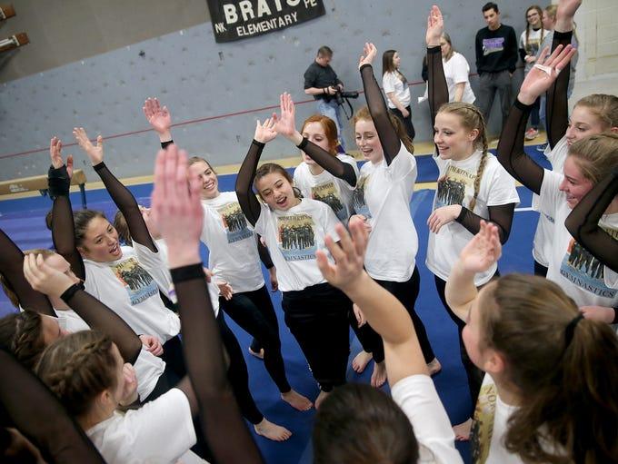 The North Kitsap gymnastics team greats ready to meet