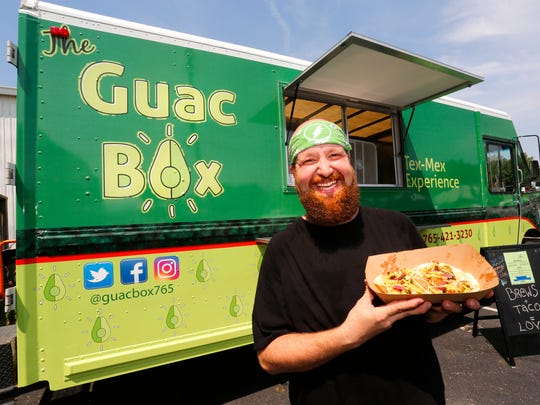 Matt Bestich of The Guac Box with Adam tacos, featuring marinated chicken, onions, poblanos, pickled red onions, cilantro and guac sauce, Thursday, July 12, 2018, outside People's Brewing Company in Lafayette.