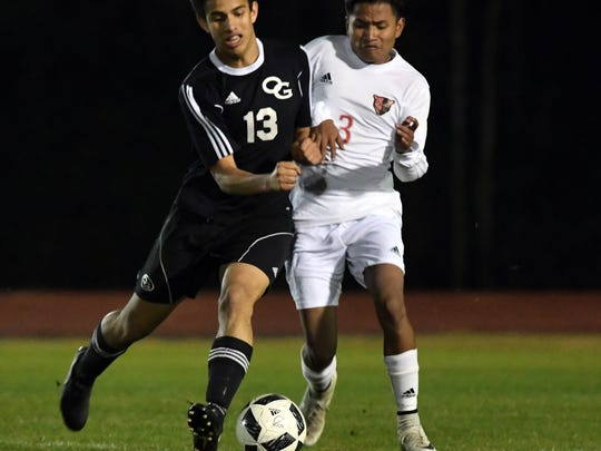 Oak Grove's Elian Fajardo fights off Petal's Jose Marquez in a game against at Petal on Friday.