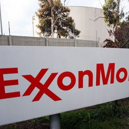 Analysts expected plunging oil prices to drive down Exxon Mobil's per-share earnings by more than half in the fourth quarter.