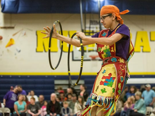 River White, 14, of London, Ontario, dances with hoops during the Algonac American Indian Festival and Powwow Saturday, April 30, 2016, at Algonac High School.