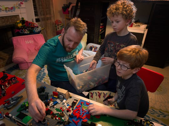 Josh Collins enjoys playing with Legos with his sons