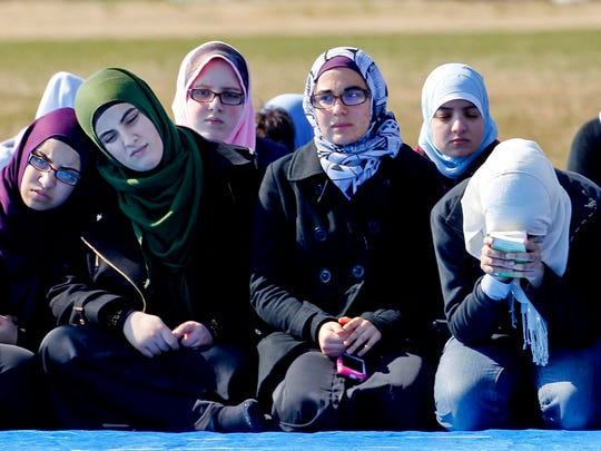 Mourners gather for the funerals of Deah Shaddy Barakat, 23; his 21-year-old wife of less than two months, Yusor Mohammad Abu-Salha; and her 19-year-old sister, Razan Mohammad Abu-Salha, at the Method Road Soccer Complex Thursday, Feb. 12, 2015, on the North Carolina State campus in Raleigh, N.C.