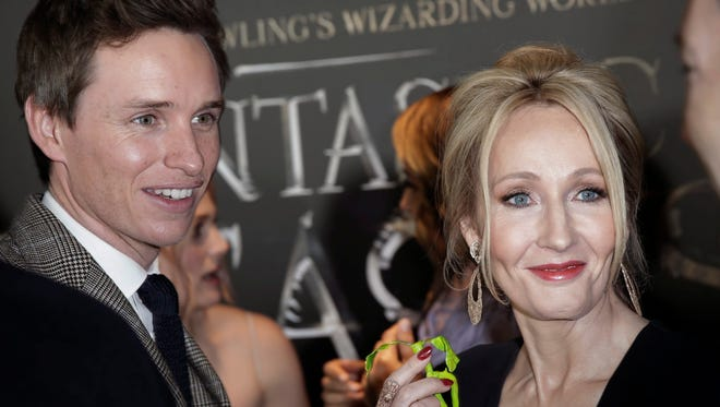British novelist, screenwriter and producer J.K. Rowling, right, with star Eddie Redmayne, attends the world premiere of 'Fantastic Beasts And Where to Find Them' in New York on Nov. 10. The movie will open in theaters on Nov. 18.