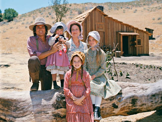 "The star 'Prairie' family. From left to right: Michael Landon (""Charles Ingalls ,"" left), Lindsay Greenbush (""Carrie Ingalls,"" left center), Karen Grassle (""Caroline Ingalls,"" back center), Melissa Gilbert (""Laura Ingalls Wilder,"" front center) and Melissa Sue Anderson (""Mary Ingalls,"" right) ."