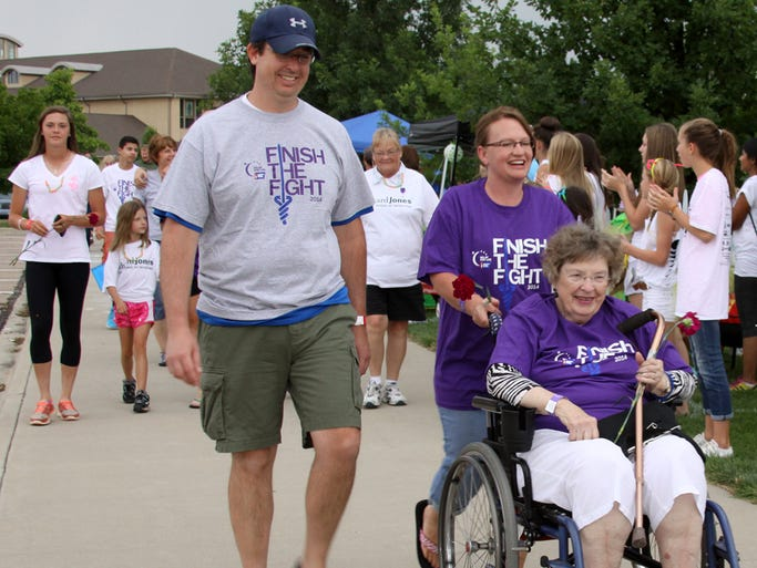 Residents walk laps during the American Cancer Society Relay for Life event Friday at Eastman Park in Windsor. The goal was to raise money for research and treatment.