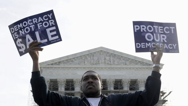 A protester outside the Supreme Court demonstrates against campaign finance corruption.