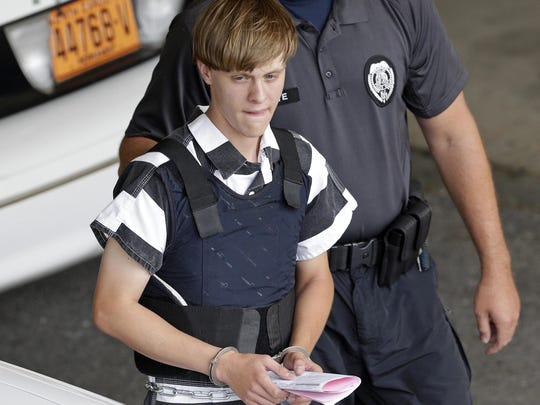 Dylann Roof is escorted from the Cleveland County Courthouse in Shelby, N.C., in this file photo. A federal jury has sentenced Roof to death for killing nine black church members in a racially motivated attack in 2015.