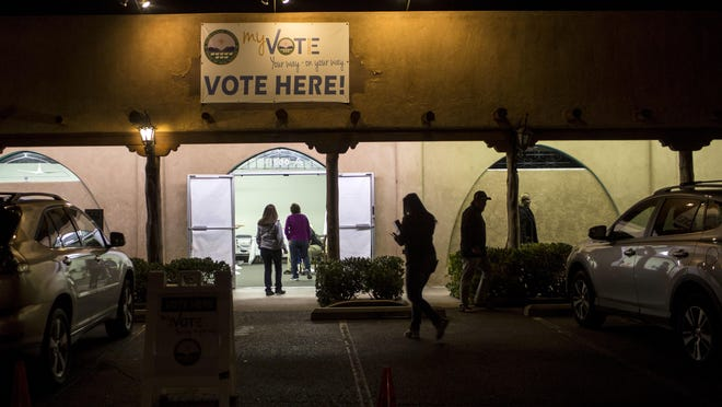 Voters cast ballots at a polling station on Tuesday in Albuquerque.