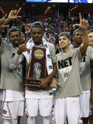 USP NCAA Basketball_ NCAA Tournament-Florida vs Da_002