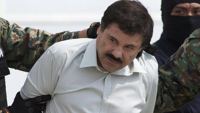 In this Feb. 22, 2014, file photo, Joaquin 'El Chapo' Guzman, head of Mexico's Sinaloa Cartel, is escorted to a helicopter in Mexico City, following his capture overnight in the beach resort town of Mazatlan.
