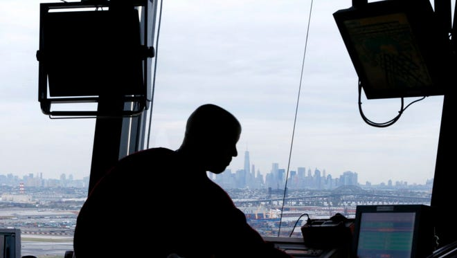 An air traffic controller works in the tower at Newark Liberty International Airport in Newark, N.J., on May 21, 2015.