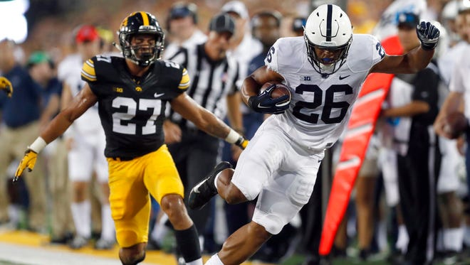 Penn State running back Saquon Barkley, right, is unable to stay in bounds as Iowa defensive back Amani Hooker watches during the first half of an NCAA college football game Saturday, Sept. 23, 2017, in Iowa City, Iowa. (AP Photo/Jeff Roberson)