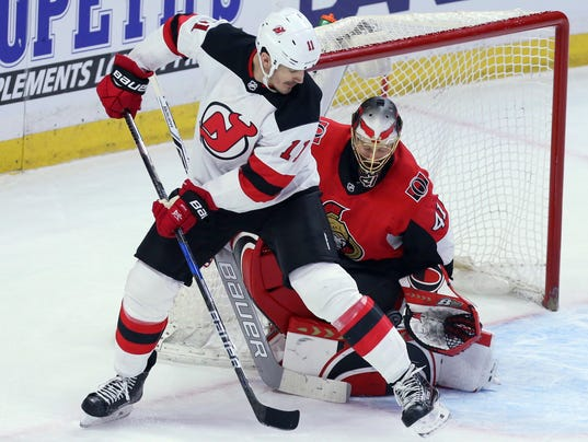636535524916540808-Devils-Senators-Hockey-17683933.JPG
