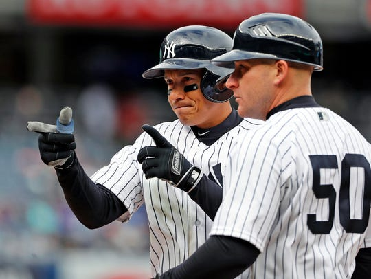 New York Yankees' Ronald Torreyes, left, gestures toward
