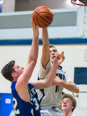 Mt. Mansfield Union's Zach Reinhardt, right, blocks a shot by Colchester's Stephen Emmons in Jericho on Thursday, January 11, 2018.