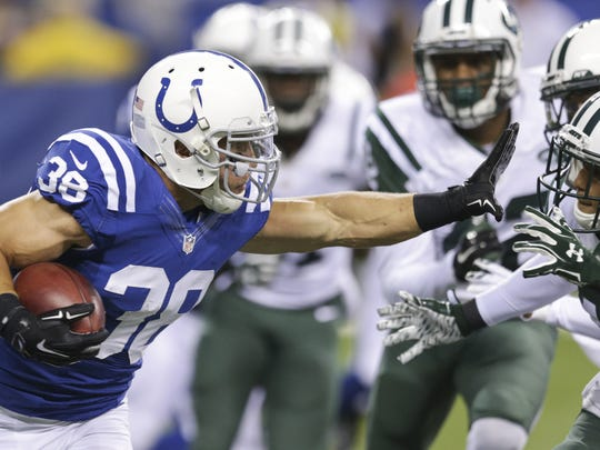 Indianapolis Colts fullback Tyler Varga (38) looks to stiff-arm a Jets defender on a kick return, Colts vs. Jets, Lucas Oil Stadium, Indianapolis, Monday, Sept. 21, 2015. New York won 20-7.