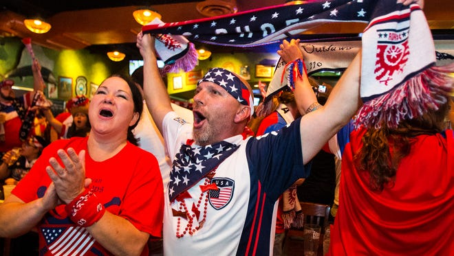 Fans of the US World Cup soccer team cheer during match with Germany in World Cup action while watching the game at The Tilted Kilt in Phoenix, Thursday, June 26, 2014.  From left to right in front row, Michelle Ribadeneira, New River, and Dennis Karrick, Gilbert.