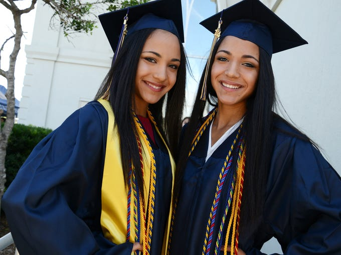 Sisters Daryth and Gabrielle Gayles pose for photos before Holy Trinity Episcopal Academy graduation in Melbourne.