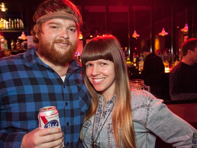 Lyle Edward and Joann Jene get closer for the shot during the Old Baby show at Headliners Music Hall Friday night.