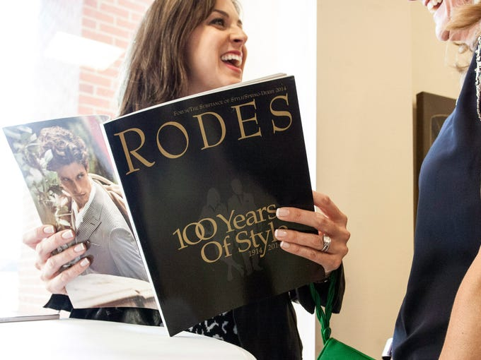 Fran Thornton checks out the printed history of Rodes, and its century of style, during the 100th birthday party for Louisville's last remaining local department store. The well-attended event was held at the Brownsboro Road location on Monday night.