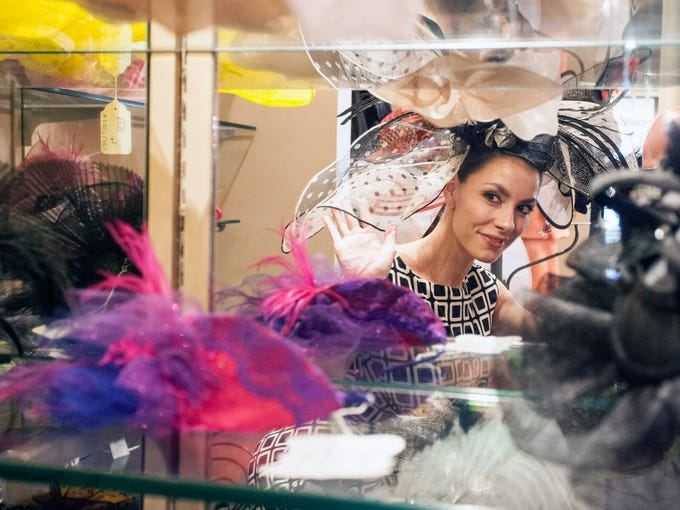Jacqueline Grimm shops for the perfect hat during the Derby Fashion Night Out at Rodeo Drive in the Holiday Manor on Thursday night.
