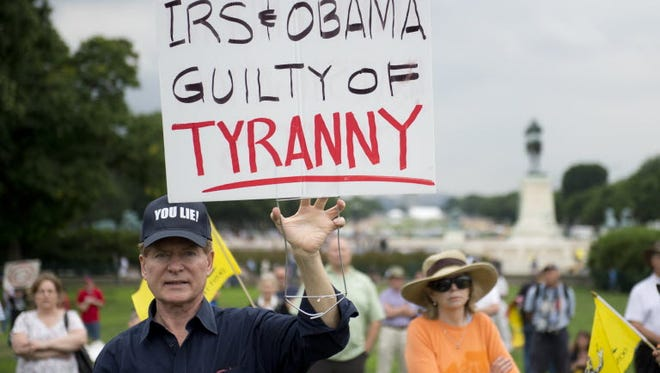 Tea Party demonstrators protest IRS outside the Capitol in Washington, June 19, 2013.