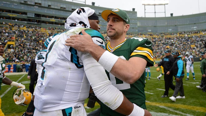 Green Bay Packers quarterback Aaron Rodgers visits with Carolina Panthers quarterback Cam Newton after Sunday's game at Lambeau Field. The Packers defeated the Panthers 38-17. Evan Siegle/Press-Gazette Media