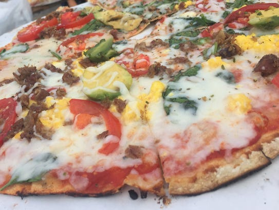 Byrne's Grilled Pizza cooks top and grill their signature