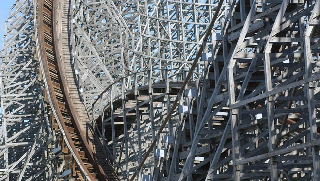 The track of the Mean Streak twists high into the sky as its wooden planks criss cross each other at Cedar Point.