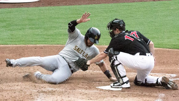 Tony Sanchez of the Salt Lake Bees is tagged out at