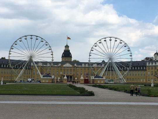 Karlsruhe Palace features two Ferris Wheels set up