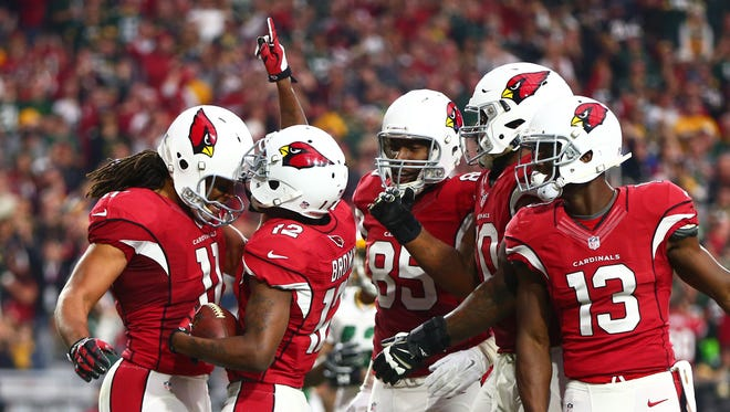Arizona Cardinals wide receiver John Brown (12) celebrates with teammate Larry Fitzgerald (11) after scoring a touchdown in the second quarter against the Green Bay Packers at University of Phoenix Stadium.