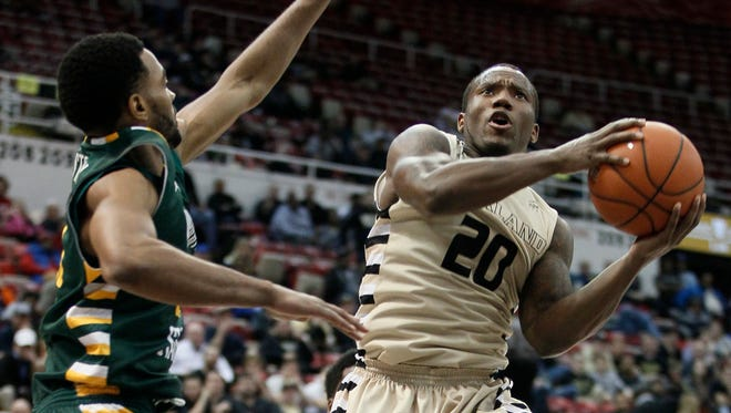 Oakland's Kay Felder (20) goes to the basket against Wright State's Mark Alstork during the Horizon League tournament on March 7 in Detroit.