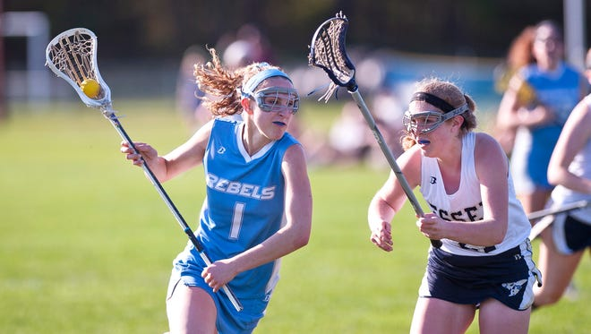 South Burlington's Willow Yager, shown in action last year, scored the winning goal in the Wolves' 12-11 triumph over MMU on Monday.