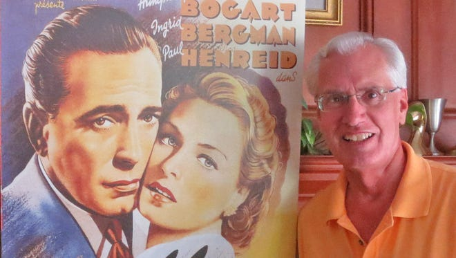 """Rich Santel and a poster from his favorite film, """"Casablanca."""""""