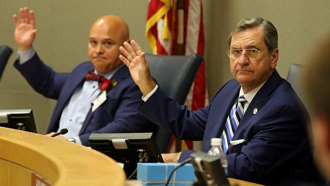 New ChairmanTom Keigher and others take part in a organizational meeting for county commissioners held Monday morning, Dec. 7, 2020, in the Harley B. Gaston Jr. Public Forum at the Gaston County Courthouse.