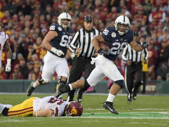 Penn State tailback Saquon Barkley, shown here in the Rose Bowl against USC, is one of two Heisman Trophy hopefuls for the defending Big Ten champion.