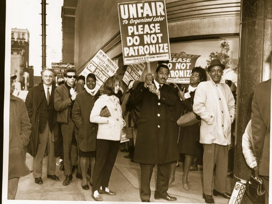 U.S. Rep. John Conyers protests at a Detroit clothing store in 1965.