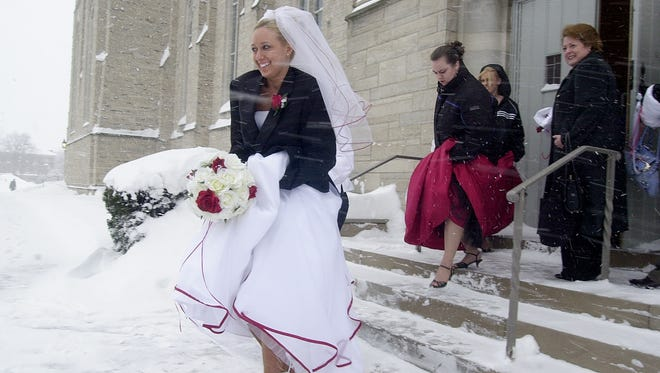 Bride Rachelle Lynn, 22 years old of Hilton, NY, exits Asbury First United Methodist Church after her Valentines Day Wedding to groome Jeffery Edward Ross.  Photograph by Katharine Sidelnik, Staff Photographer, Democrat and Chronicle.  021407
