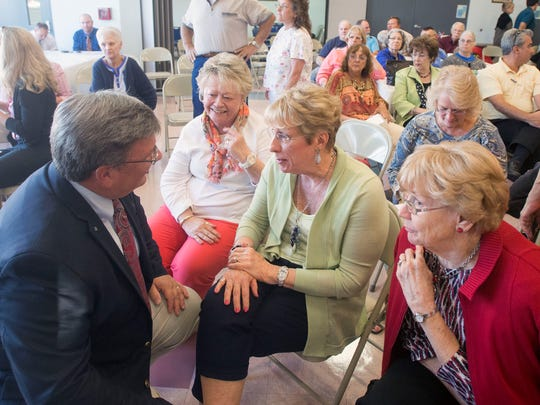 State Senate candidate Mike McDermott speaks with Ocean Pines resident Ann Lutz as the debate breaks for a few minutes Wednesday at the Ocean City Senior Center.